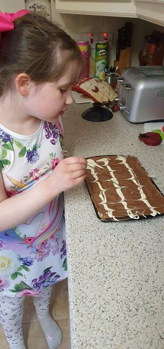 Sophie feathering the chocolate!