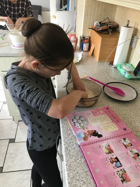Mia following her biscuit recipe!