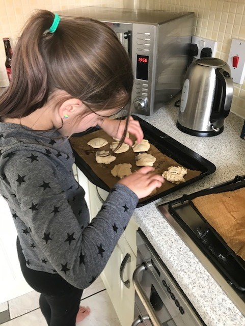 Mia finishing her biscuits off before baking them!