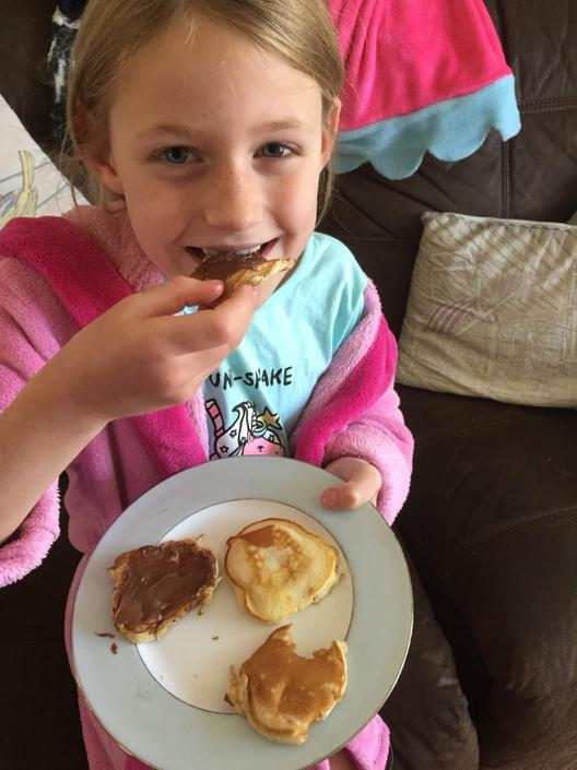 Edie enjoying her pancakes!