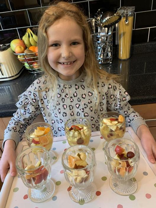 Here is Jorja ready to serve her delicious fruit salads!