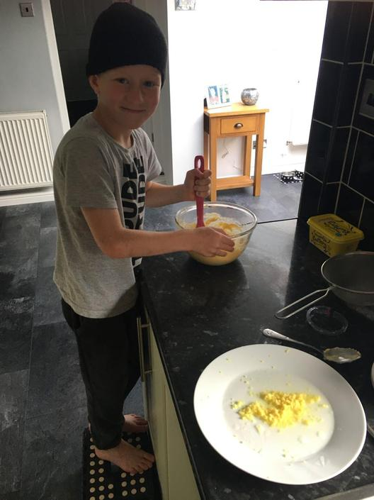 Harvey making lemon buns independently!