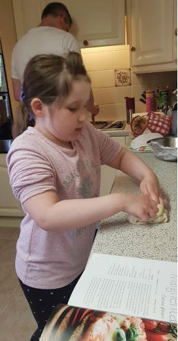 Sophie kneading the dough for her pizza!
