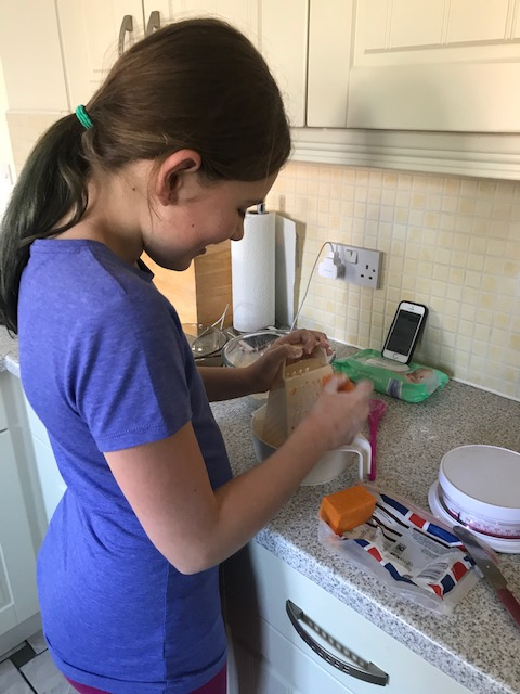Lauren busily grating cheese!