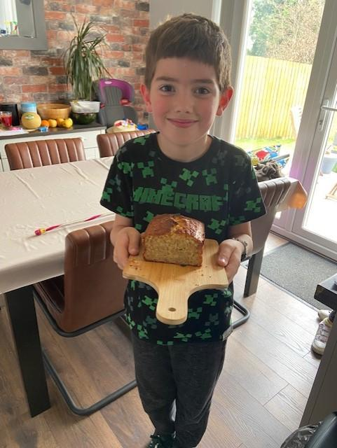 Oliver proudly showing his banana bread!