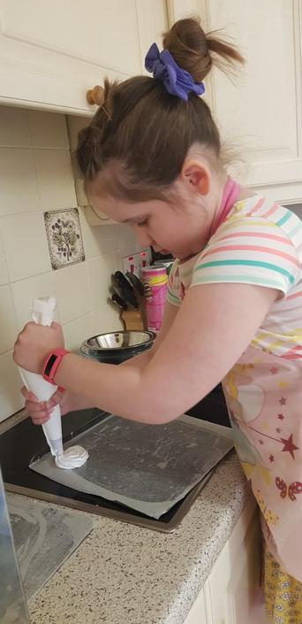 Sophie piping meringues!