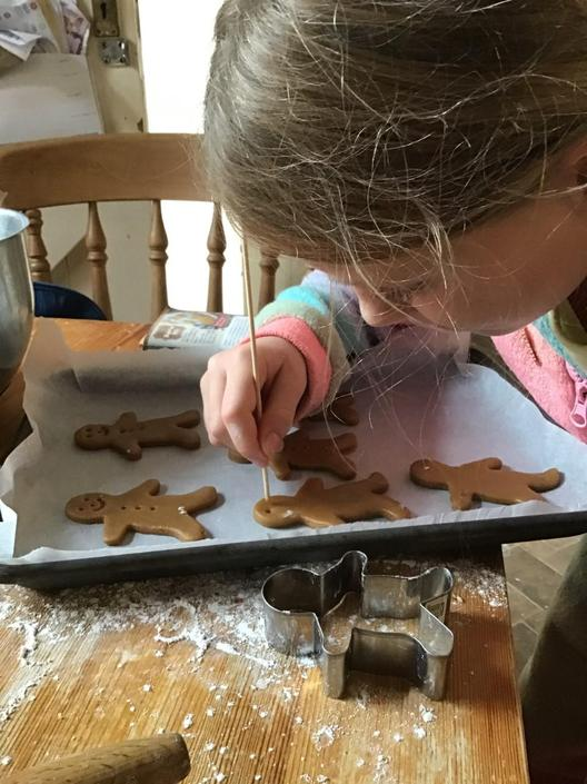 Edie making gingerbread men!