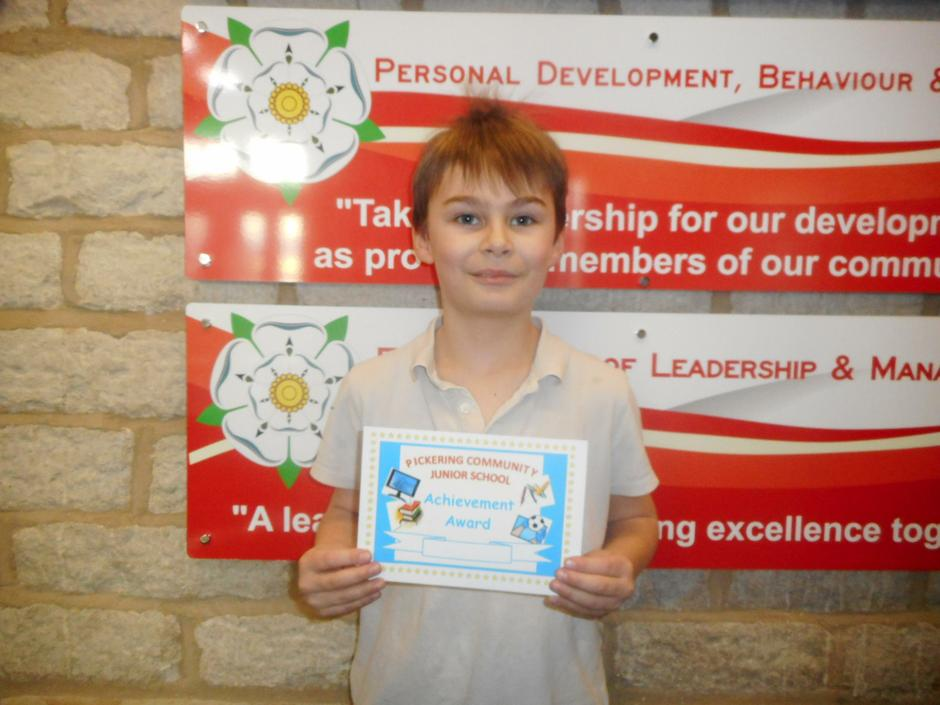 For doing really well in swimming and reading!