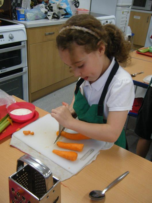 Year 5 making vegetable Sticks with a yoghurt dip