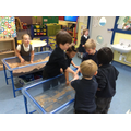 Playing together in the water and sand trays!