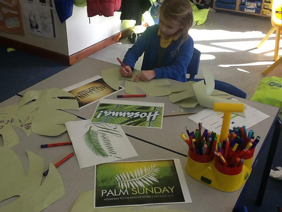 Writing HOSANNA on palm leaves