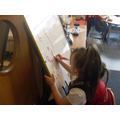 Practising our letters on the 'teacher's board.