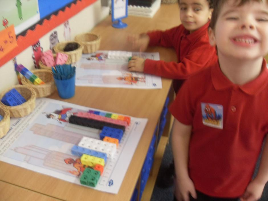 Making towers to match numbers to 10.
