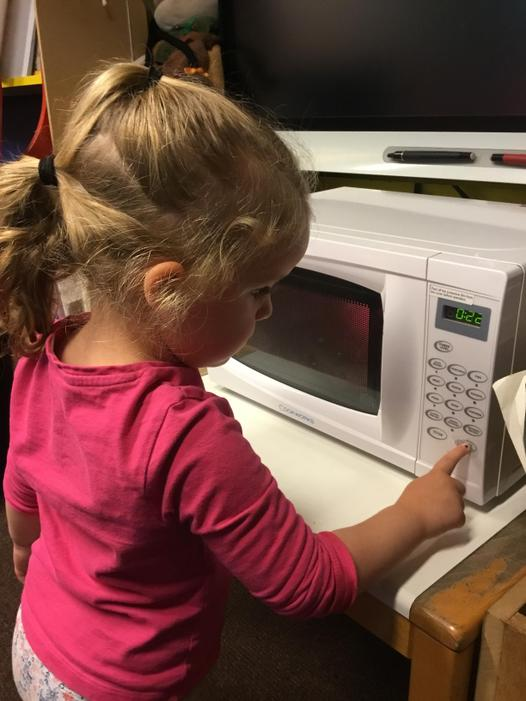 Using the microwave.