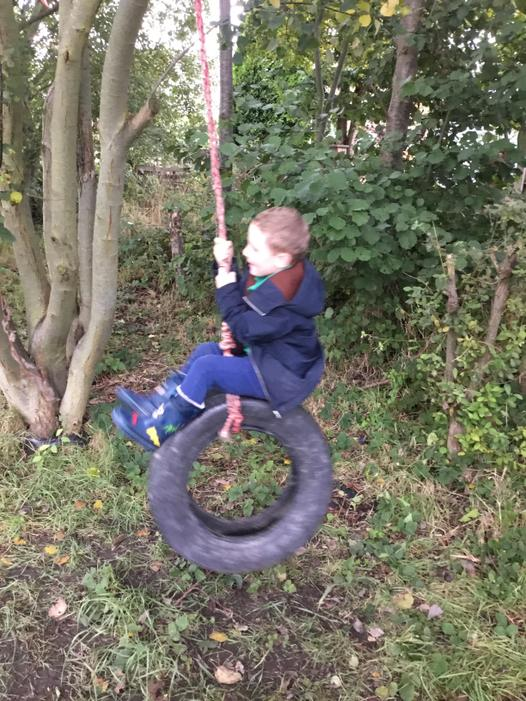 Having lots of fun on the tyre swing