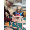 Creating clay tiles at the Cathedral