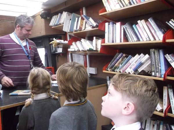 Checking out our books with Librarian Andy