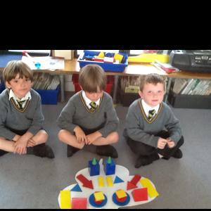Using shapes to create a symmetrical butterfly!