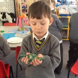 We have been creating clay dinosaurs!