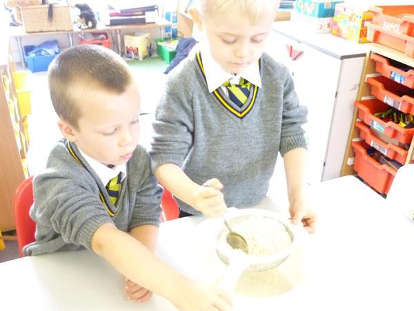 Sieving the flour to create some air in the dough!