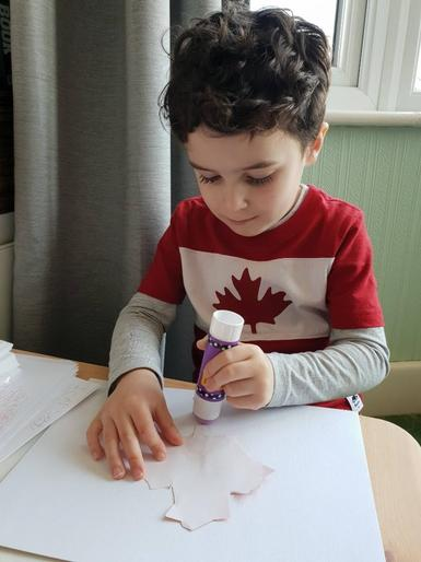 Zachary learning about Canada