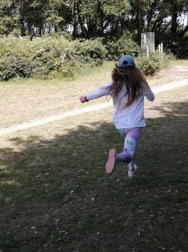Emily mid-sprint