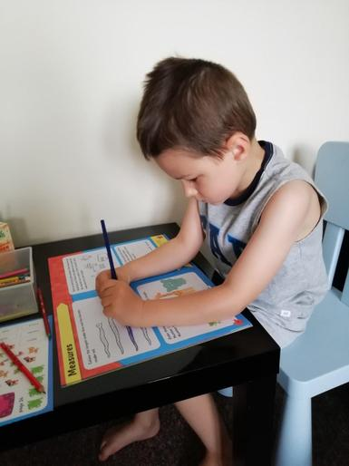 Tomas concentrating hard on his learning at home