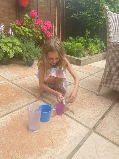 Olivia experimenting with volume and capacity