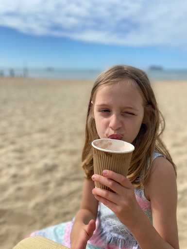 Olivia enjoying an early hot chocolate