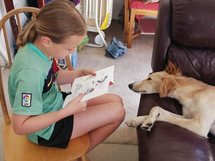 Sammy reading to her dog!
