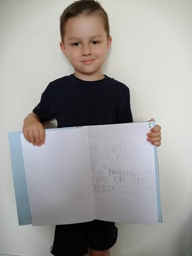 Tomas very proud of his super writing!