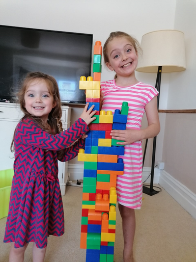 Phoebe helped her sister to build a tall tower