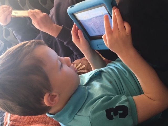 Bobby learning on his tablet