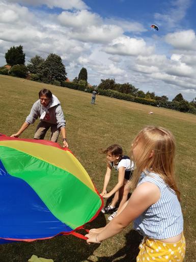 Neve enjoying the sunshine and parachute!