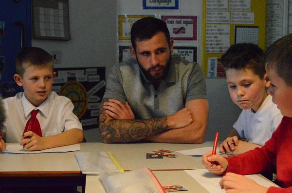 Steve Cook (Defender) working with pupils from Y6