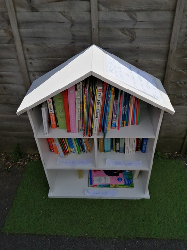 Mabel and Lyra set up a 'book swap' station