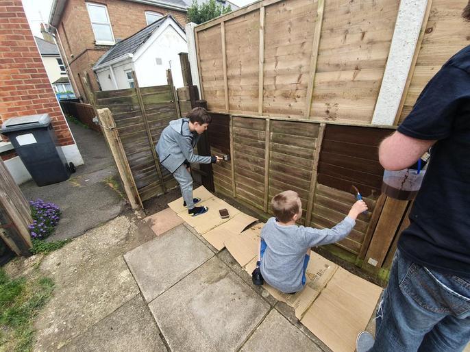 Benas and Joris painting the fence