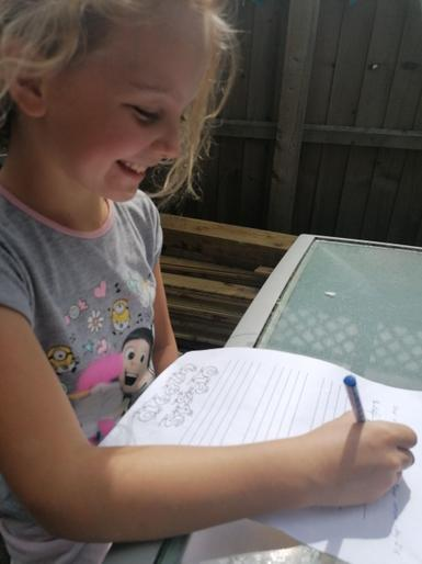 Phoebe writing in the garden!