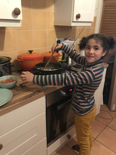 Kaia busy cooking!
