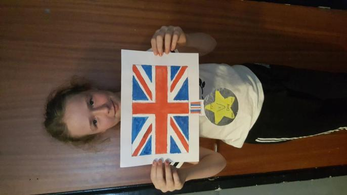 Caitlin, her Union Jack and her VE Day medal