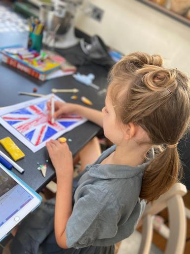 Olivia colouring her Union Jack!