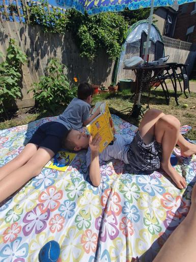 Joris enjoying a read in the sunshine