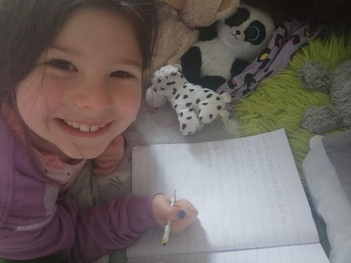 Holly enjoying her writing!