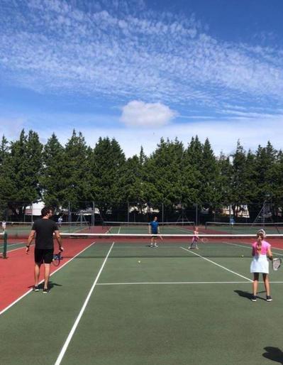 Eva enjoying tennis!