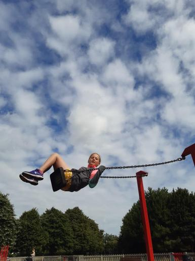 Neve flying on a swing