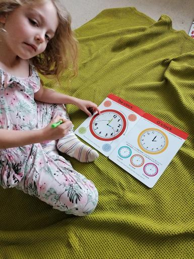 Phoebe learning to tell the time!