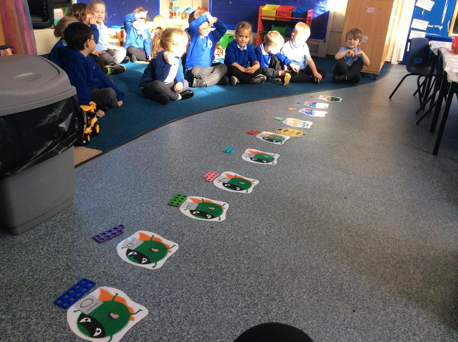Squashing Evil Peas. We practised counting to 10 by jumping along an Evil Pea numberline.