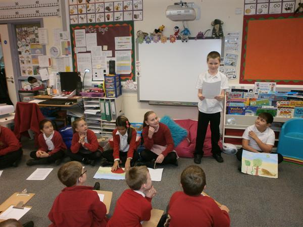 Year 5 children reading to Year 1