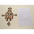 This is Grace's work with equivalent fractions - Mum made a tricky collage of coins!
