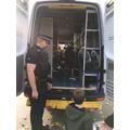 Looking inside the police van.